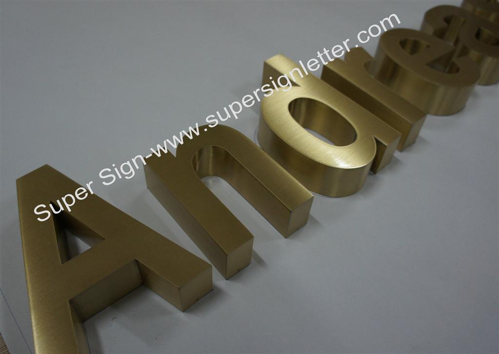 built-up brushed brass sign lettering